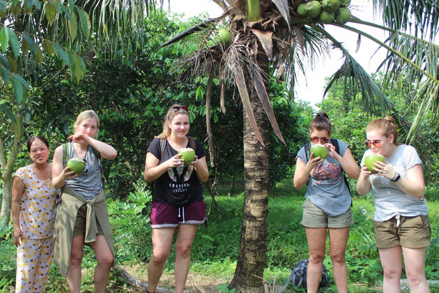 visit local village at mekong delta with family