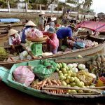 Boats full of fruit and vegetable in cai be floating market