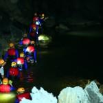 Swimming underground river in Dark cave