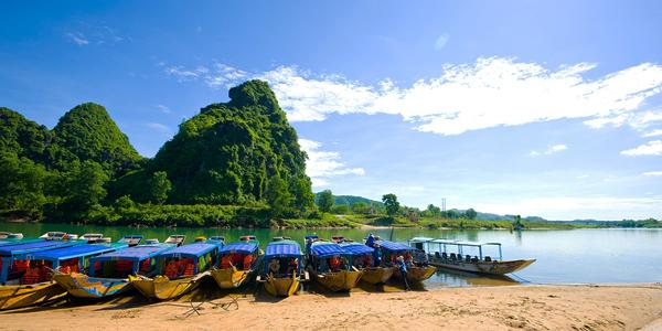 Walk to boat whraf and take a pleasant boat trip to Phong Nha Cave