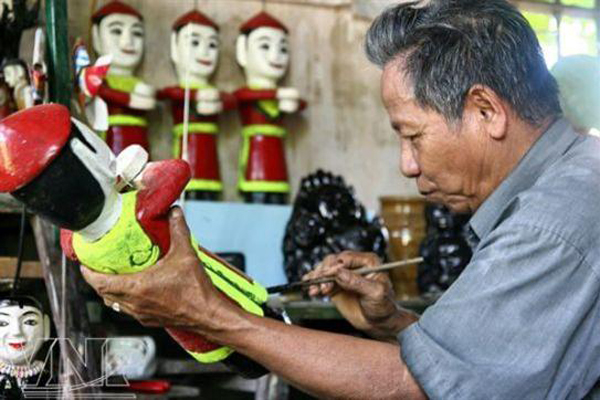 A guild is a professional craft association in each village vietnam traditional water puppetry