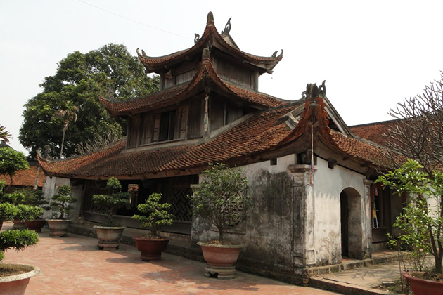 Big roof curving at four angles in Vietnamese traditional architecture