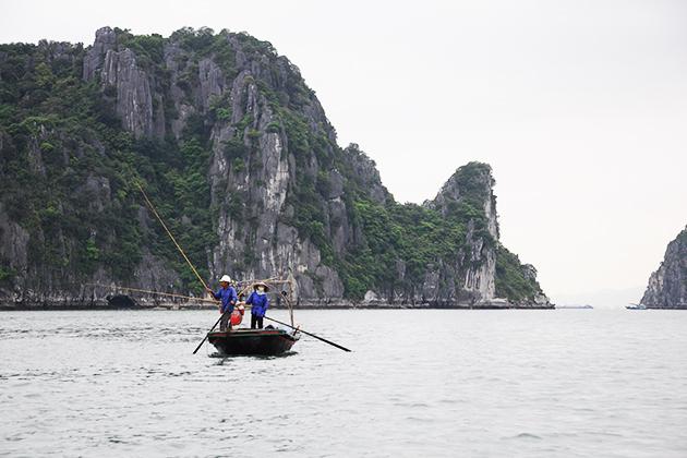 fishermen at halong bay vietnam and laos tour