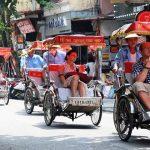 join in cyclo tour around Hanoi Old Quarter