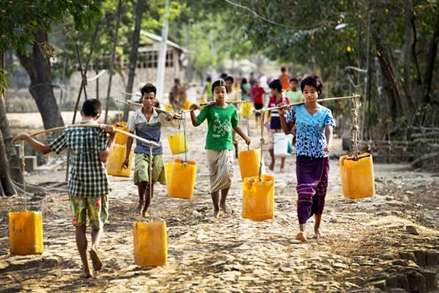 the locals taking water at dala yangon