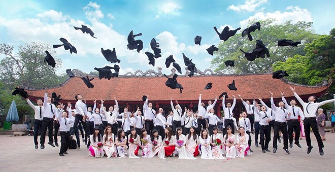 Students taking photos for their graduation at the temple of literature