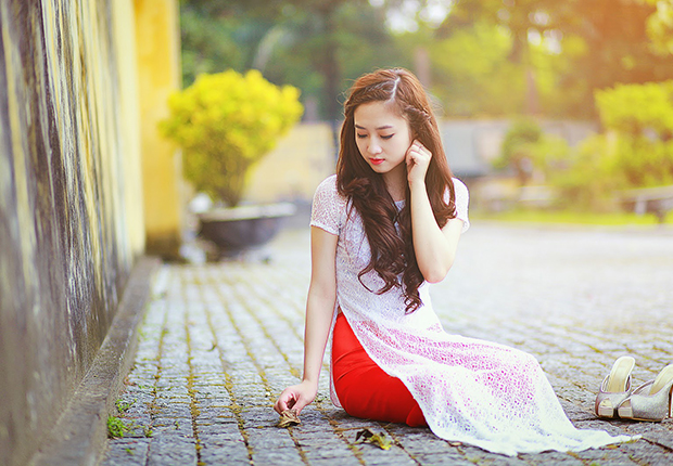 The woman in ao dai - the traditional costume of Vietnam