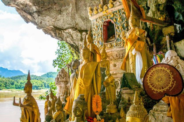 the statues inside pak ou caves in laos