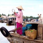 All the activities of local people on boat in Cai Be Floating Market