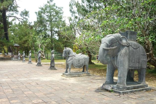 Carving stone images of Mandarins and war animals at emperor minh mang tomb