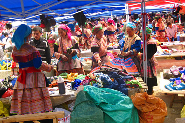 Hmong women selling and exchange the products