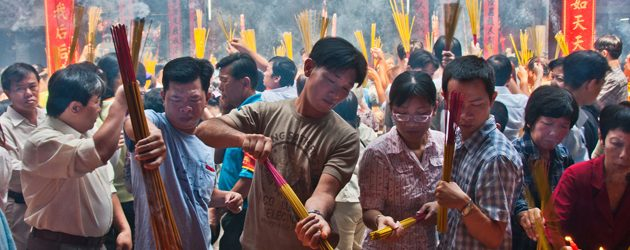 Incense burning in Tet holiday to pray for a happy and propertied new year