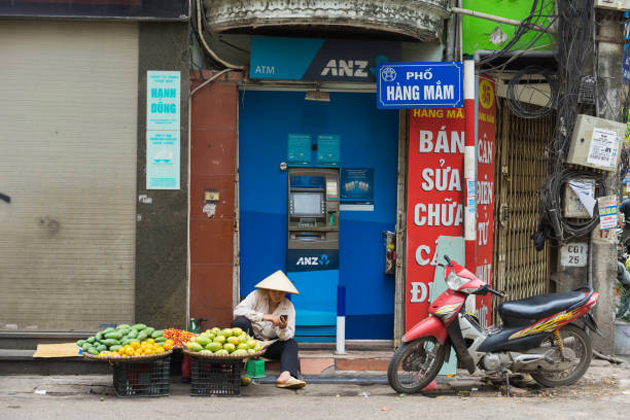 Street vendor take a short rest in Hang Mam Street Hanoi Old Quarter