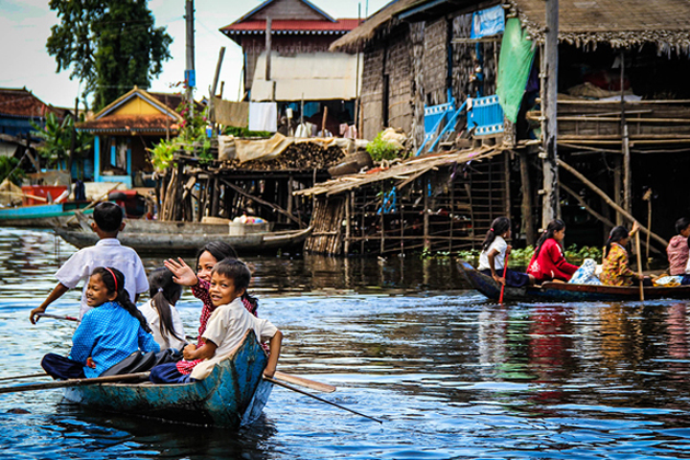 Local family boating home in Chong Kneas Floating Village