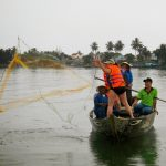 See and try casting fishing net on boat