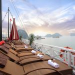 See sun rise over Bai Tu Long Bay on the sundeck