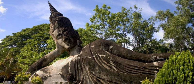 lying buddha statue in luang prabang