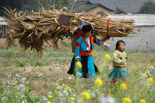 Ethnic woman and her child after farm time daily life in vietnam