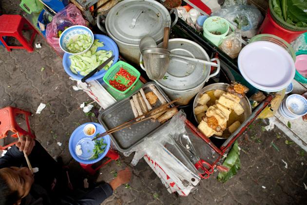 Preparing food in the streets of Hanoi, Vietnam
