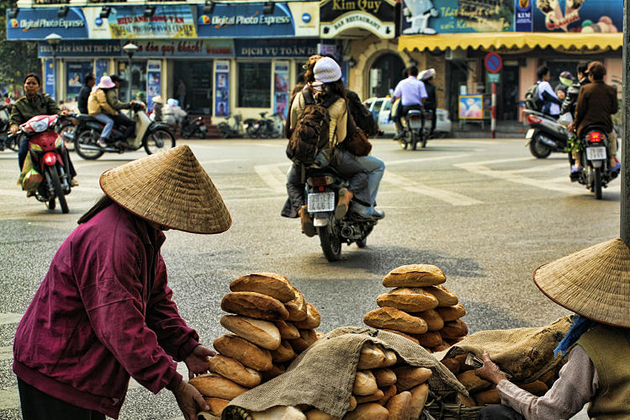 Two old ladies selling breads on the street of Hanoi, Vietnam daily life