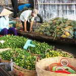 cai be floating market in mekong delta vietnam