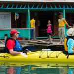 visit floating market in halong bay family tour