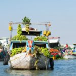 Boat full of fruit and vegetable in Chau Doc