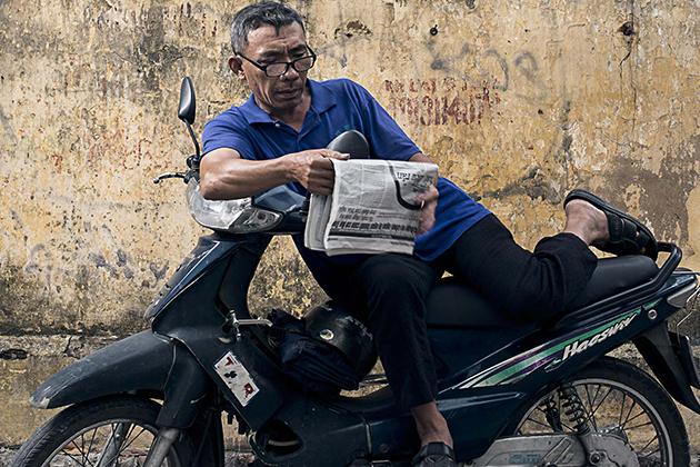 Old Vietnamese Motorbike Driver
