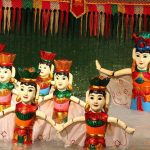 enjoy water puppet show in northern vietnam family holiday