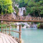 kuang si waterfall with wooden bridge 1