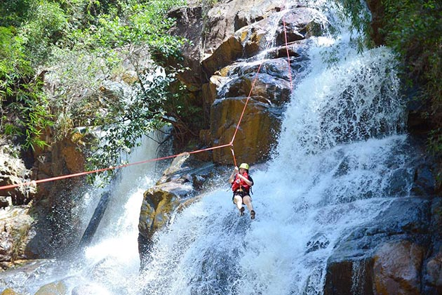Conquering the waterfall by rope in Dalat