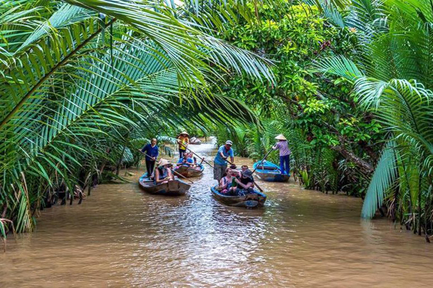 boat cruise through canal mekong delta tour
