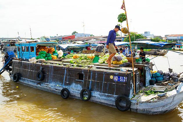 vibrant floating market in mekong delta