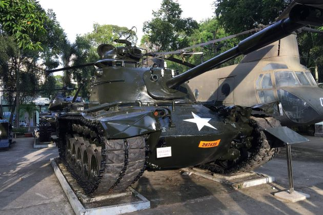 a tank and a helicopter at saigon war renmant museum