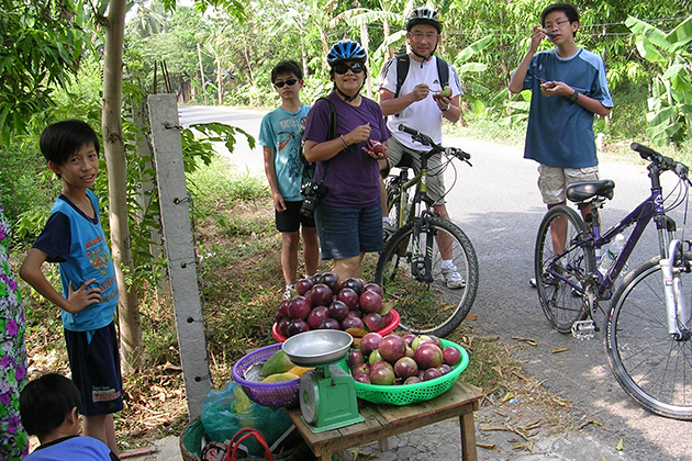 cycling along countryside in vietnam
