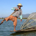 leg-rowing fishermen in inle lake