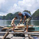 visit halong bay fishing village with kids