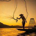 fishermen in tonle sap lake