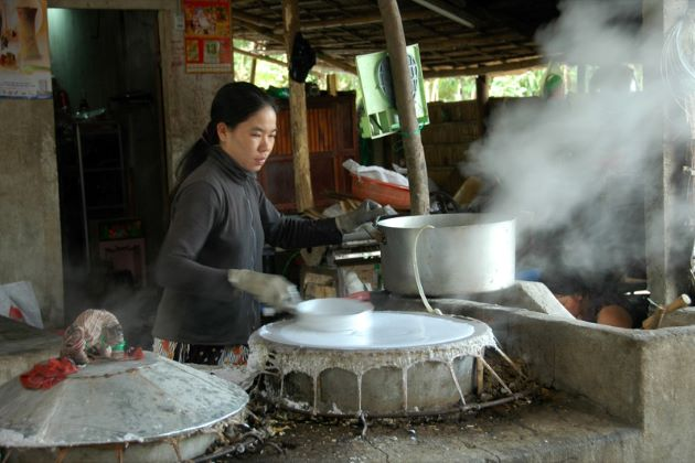 rice noodle making family in mekong delta