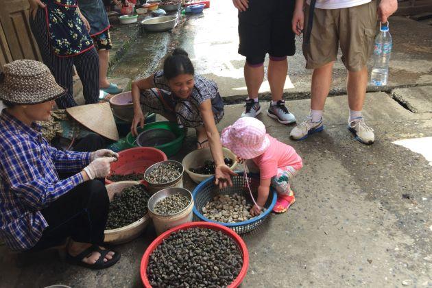 family visit local market in dong ngac village