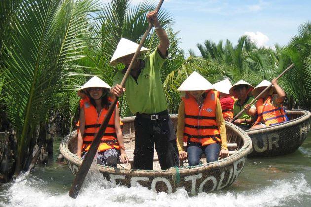 sit on bamboo basket boat in vietnam