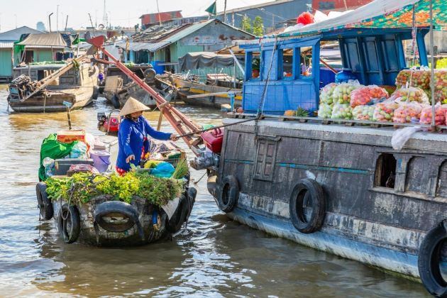 cai be floating market in mekong delta indochina holiday packages