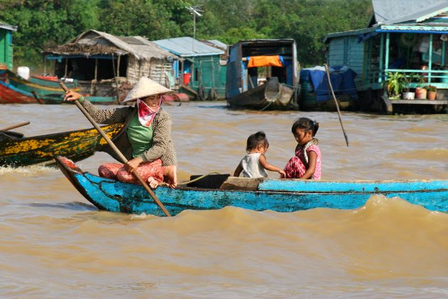 cambodia family travel brings family to floating villages on tonle sap lake