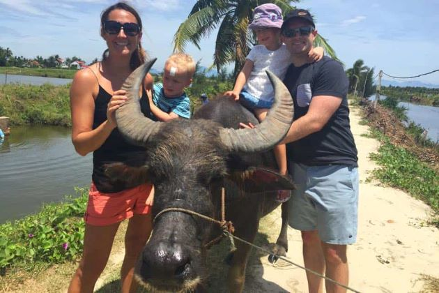 riding a buffalo in hoi an vietnam family holiday packages