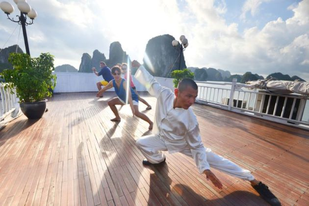practice taichi with master at halong bay in the morning