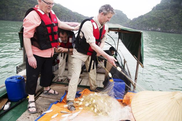 visit a fishing village in halong bay