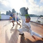 practice taichi exercise at halong bay