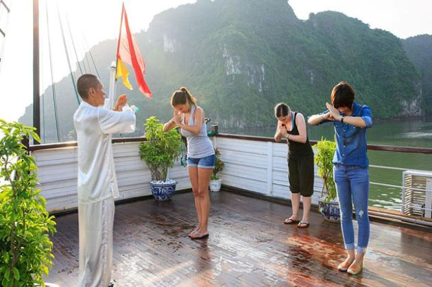 practice tai chi exercise in halong bay